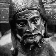 Бронзовая купель собора в Гильдесгейме, Фрагмент-голова фигуры, символизирующей райский источник Физон