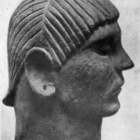 Голова с погребальной урны из Кьюзи. Начало 6 в. до н. э. Глина. Кьюзи. Музей